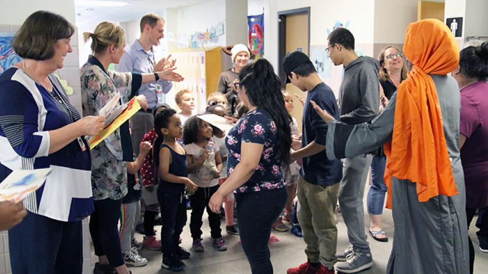 FAHS students are greeted by pre-K students.