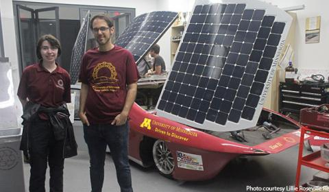 Students stand with their solar-powered vehicle to race in Australia this fall.