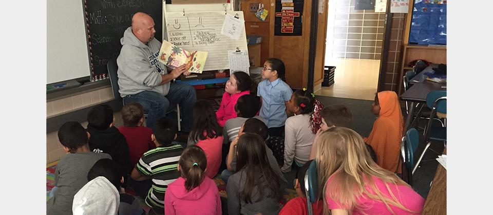 Principal is reading to students