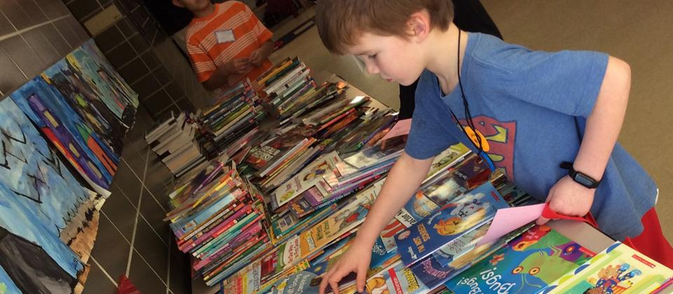 Boy selecting a book